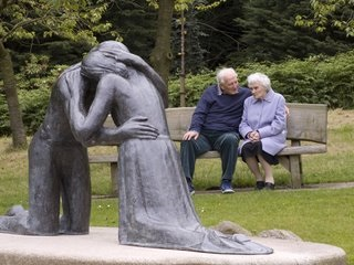 Thriving-Baby-Boomers - Relationships - Old Couple on bench - young couple in Love statue