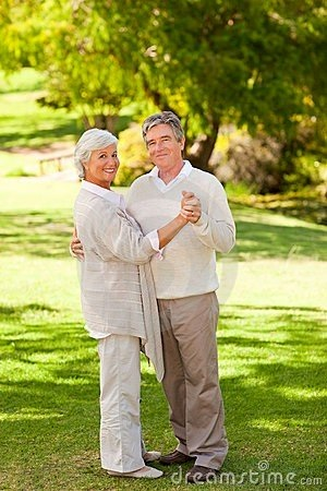 Thriving-Baby-Boomers - Casual Dating - Seniors dancing in park