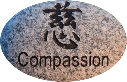 Thriving-Baby-Boomers - Compassion - Asian calligraphy for Compassion on a rock