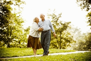 Thriving-Baby-Boomers - Cherish - Senior couple walking in park.