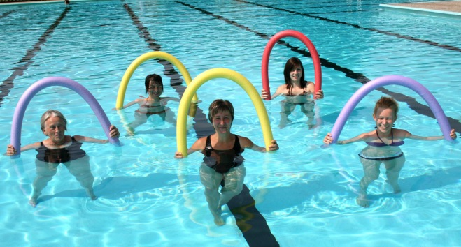 Thriving-Baby-Boomers - AquaFitness - AquaFit participants using pool noodles