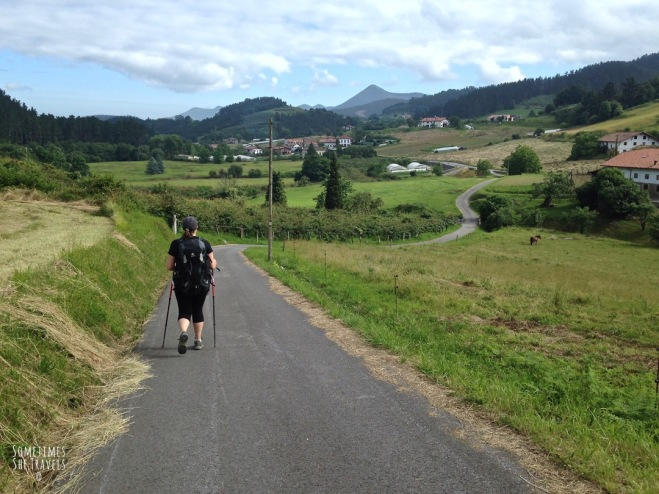 Thriving-Baby-Boomers - Backpacking - Lush green fields; backpacker walking the Camino