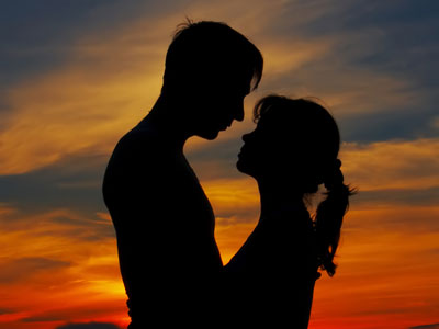 Thriving-Baby-Boomers - casual dating - sexual compatibility - Lovers silhouetted at sunset
